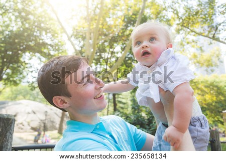 Young Man with Little Brother at Park