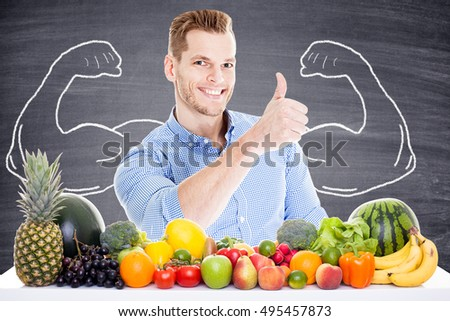 young man with muscles and healthy food - drawn biceps