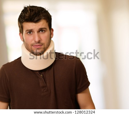 Young Man With Neck Brace, Indoor - stock photo