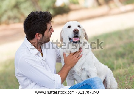 young man with old senior labrador dog,selective focus