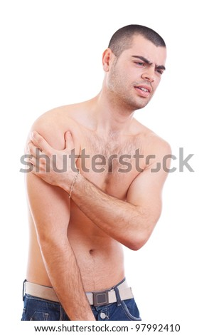 Young man with pain in her arm. Isolated