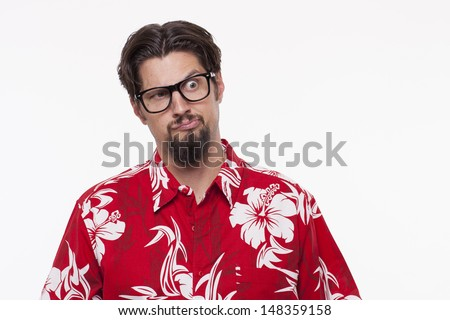 Young man with raised eyebrow  - stock photo
