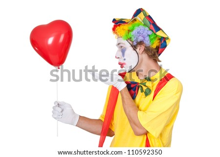 Young man with red heart shaped balloon - isolated - stock photo