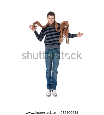 young man with scarf jumping  - stock photo