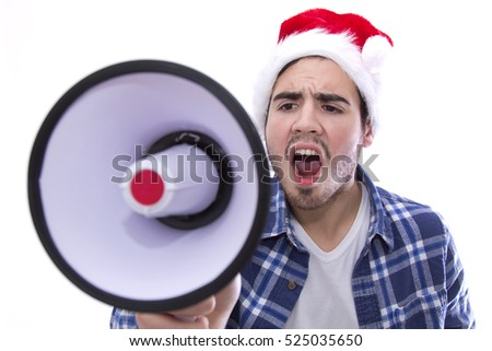 young man with screaming with the megaphone santa Hat