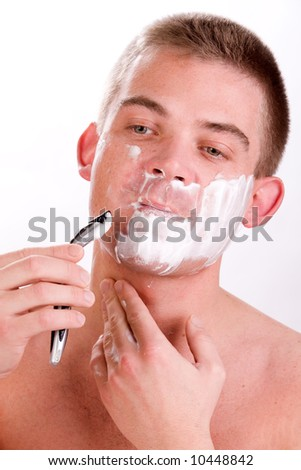 Young man with shaving foam on his face