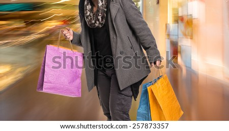 Young man with shopping bags in the mall