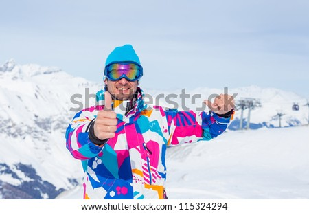 Young man with skis and a ski outfit in the Zillertal Arena, Austria - stock photo