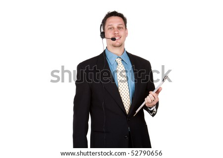 Young man with smart suit and headset, looking at camera - stock photo