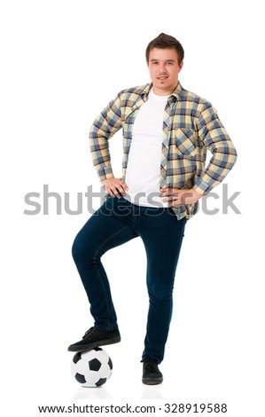 Young man with soccer ball, isolated on white background - stock photo