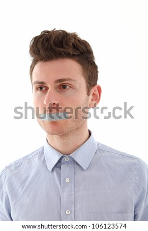 Young man with tape for censorship - stock photo
