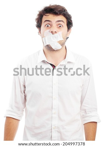young man with tape over his mouth - stock photo