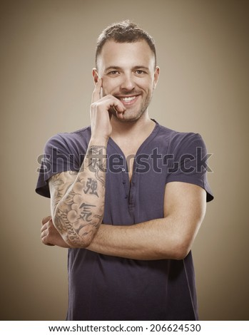 Young man with tattoo - stock photo