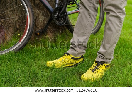 Young man with the bicycle in the park