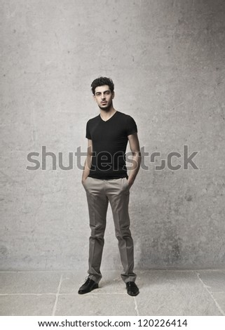 Young man with the hands in pockets - stock photo