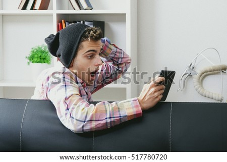 young man with the tablet in the modern home