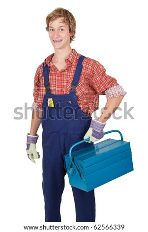 Young man with tool box in his hand - isolated on white