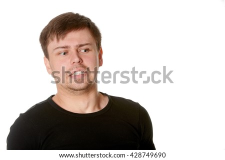 Young man with uncertain puzzled expression, on white - stock photo