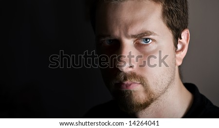 Young man with upset and serious expression