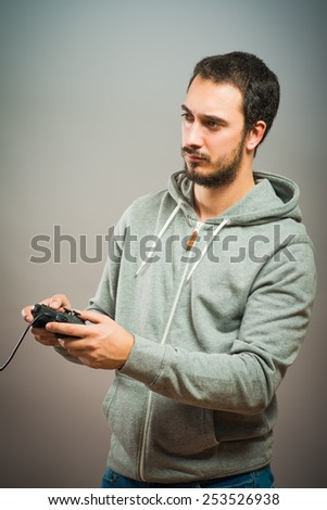 Young man with video game controllers - stock photo