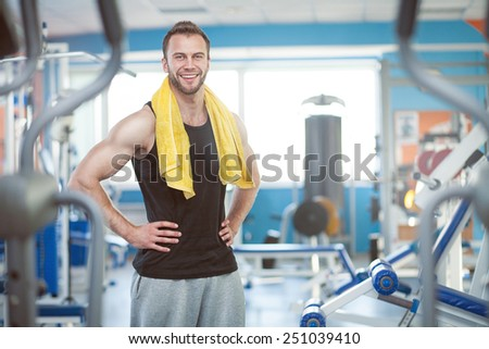 young man with weight training equipment in sport gym