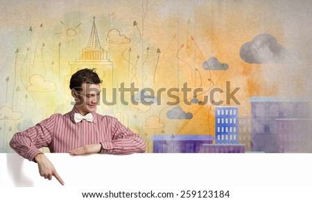 Young man with white blank banner. Place for text - stock photo