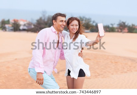 Young Man Woman Walking In Desert Couple Girl And Man Hold Hands Sand Dune Landscape Nature Background