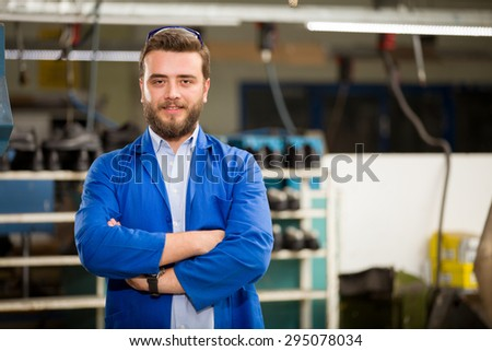Young man working in shoes factory. - stock photo