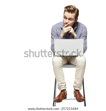 Young man working on a computer and thinking. Facial Expression. - stock photo