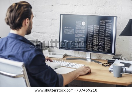 Young man working on his computer