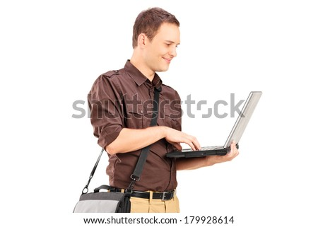 Young man working on laptop isolated on white background - stock photo