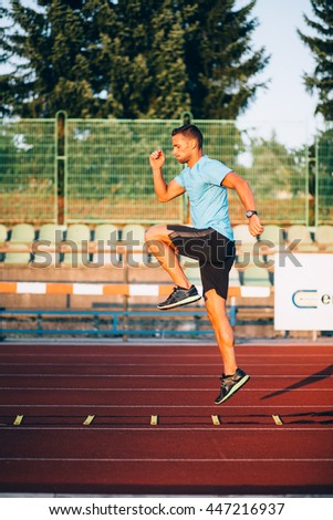 Young man working out on running track