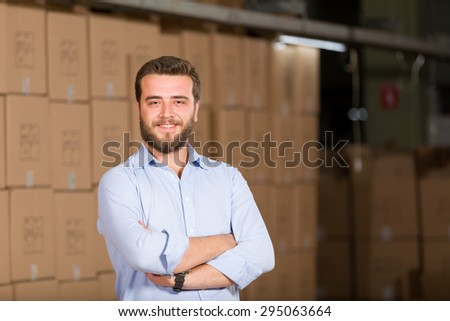 Young man working warehouse. - stock photo