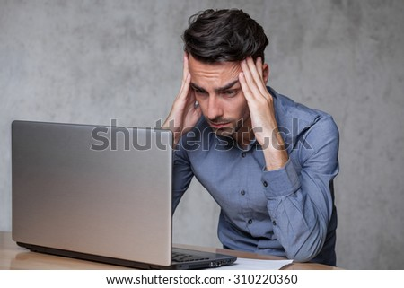 young man working with headache