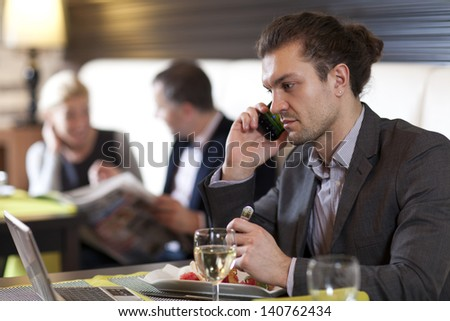 Young man working with laptop - stock photo