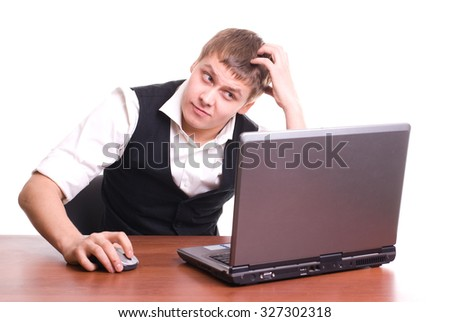 Young man works on his laptop isolated