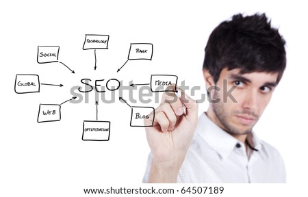 Young man writing a SEO schema on the whiteboard (selective focus) - stock photo