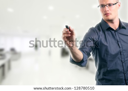 young man writing something with marker in the office - stock photo