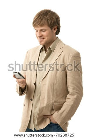Young man writing text message on smart phone, looking at screen, smiling. Isolated  on white.? - stock photo