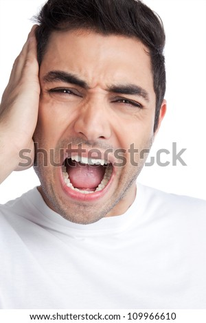 Young man yelling and covering ears isolated on white background. - stock photo