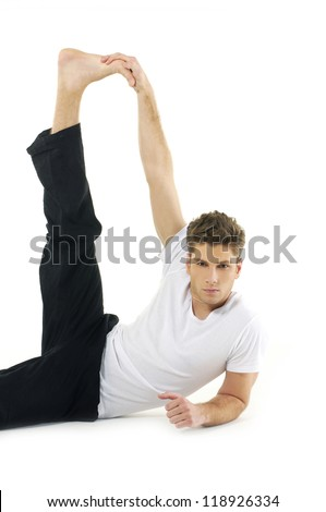 young man Yoga exercises Isolated over white background - stock photo