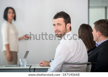 Young manager attending a business presentation posing - stock photo