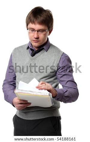 Young manager is looking through papers isolated on white background