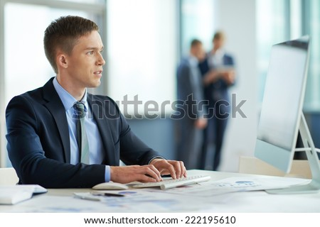 Young manager working with his pc - stock photo