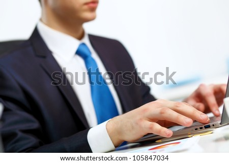 Young manager working with notebook in the office