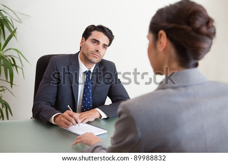 Young marketers having a brainstorming in a meeting room - stock photo