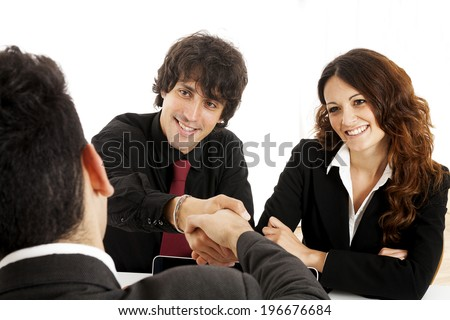 Young married couple at desk in a business meeting
