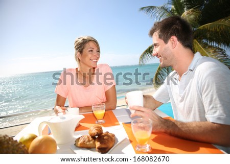 Young married couple enjoying breakfast in luxury hotel  - stock photo