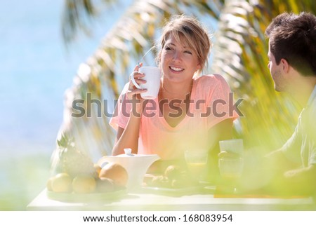 Young married couple enjoying breakfast in luxury hotel  - stock photo