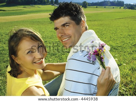 Young, married couple in a meadow. keyword for this collection is married77